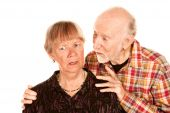 Senior Man Sharing Information With Concerned Wife