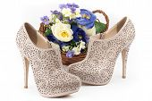 Pair Of Beige Shoes With Flowers