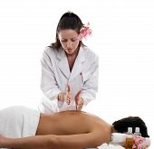 picture of massage therapy  - A masseuse performing hacking on a male customers body - JPG