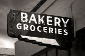 Black And White Worn Bakery And Groceries Sign