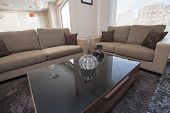 Two Brown Sofas In Lounge