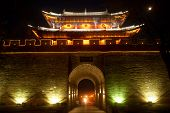 Night Scenic Of City Gate And City Wall In Ancient City Of Dali At Yunnan Province,china.
