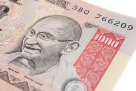 stock photo of gandhi  - The portrait of Gandhi on a one-thousand Indian rupee note. ** Note: Shallow depth of field - JPG