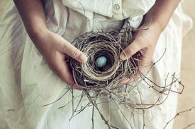 picture of nest-egg  - Vintage toned closeup of girl - JPG