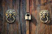 Ancient Knocker On Old Wood Door