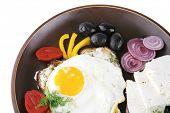 egg served on dark dish with vegetables