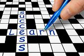 Hand filling in crossword - Learn and Success