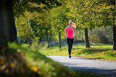 Girl running at sunny day