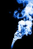 Smoke in blue color on black background