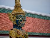 A giant porcelain guardian at the front of the Wat Arun temple in Bangkok , Thailand