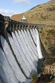 Craig Goch Dam Overflowing With Water, Elan Valley Wales.
