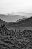 View Along Misty Valley Towards Snowdonia Mountains  Black And White