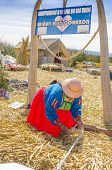 PUNO, PERU, MAY 5, 2014: Local woman in traditional costume at one of Uros Islands