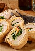image of sandwich wrap  - A turkey or chicken and cheese wrap sandwich with blue corn tortilla chips - JPG