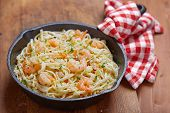 stock photo of shrimp  - Pasta with Shrimp Scampi in a pan - JPG