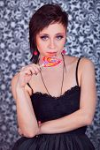 Beautiful Girl With Short Hair Licking A Lollipop