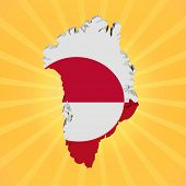 Greenland map flag on sunburst illustration