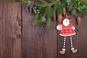 Santa Claus with Fir Branch over Wooden Background