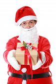 Christmas Theme: Santa Claus Asian Holding And Offering A Gift On His Hand. Isolated Over White