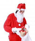Christmas Theme: Santa Claus Asian Holding And Offering A Gift On His Hand Isolated Over White Back
