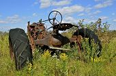 Tractor in the grass and weeds