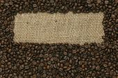 Cafe edition coffee beans frame on Jute background
