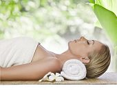 stock photo of spa massage  - portrait of young beautiful woman in spa environment - JPG
