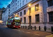 Bus on a streets of London at dusk