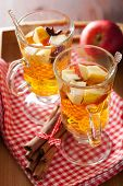 glass of mulled cider with  orange and spices, winter drink