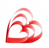 Heart shaped red paper ribbon isolated on white