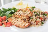 Grilled chicken meat with bulgur wheat and rocket salad