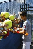 Six times Grand Slam champion Novak Djokovic signing autographs after practice for US Open 2014
