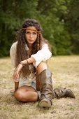 stock photo of hippy  - Beautiful hippie girl with rope in the park - JPG