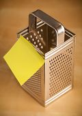 Grater with empty sticky note