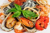 Black Pasta with sea food and basil