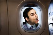 Businessman looking  through an airplane window