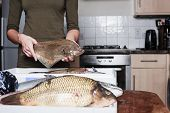Woman Holding A Plaice And Other Fish