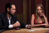 Handsome  man and beautiful woman in casino