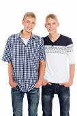 Young twin brothers isolated on white background