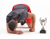 Exhausted runner after win a trophy award. tired trainer.
