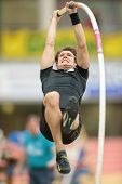 LINZ, AUSTRIA - JANUARY 30, 2014: Lukas With (#561 Austria) places 5th in the men's pole vault event in an indoor track and field meeting.