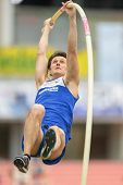 LINZ, AUSTRIA - JANUARY 30, 2014: Matteo Rubbiani (#559 Italy) places 4th in the men's pole vault event in an indoor track and field meeting.