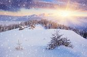 Beautiful Christmas landscape. Dawn in the mountains. The village of shepherds. Fresh snow. Carpathians, Ukraine, Europe