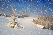 Christmas fairytale landscape. Snow covered trees and houses. Winter in the mountains. Fresh snow. Carpathians, Ukraine, Europe