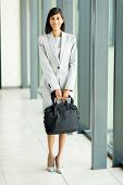 full length portrait of attractive business executive holding briefcase