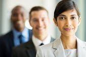 beautiful indian businesswoman standing in a row with colleagues