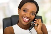 pretty african businesswoman using landline phone