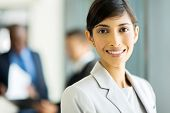 close up portrait of young businesswoman in office