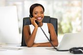 beautiful african office worker talking on telephone
