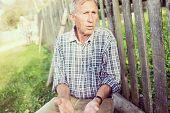 Natural senior man outdoors